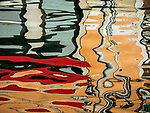 Colorful reflections in the water along Fondamenta dei Vetrai on the main canal of Murano, Italy