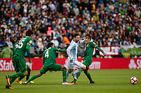 Seattle, WA - Tuesday June 14, 2016: Argentina midfielder Lionel Messi (10) fights through the Bolivian defense during a Copa America Centenario Group D match between Argentina (ARG) and Bolivia (BOL) at CenturyLink Field