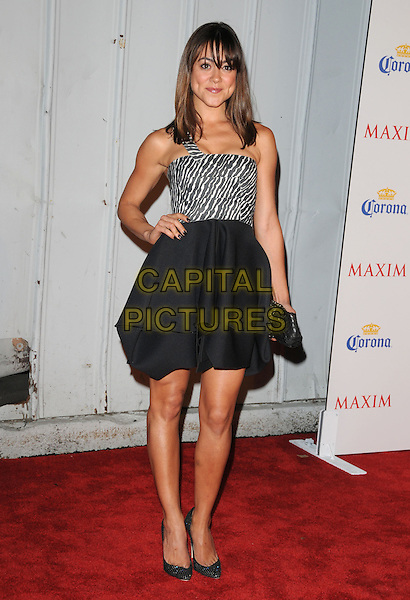 CAMILLE GUATY.The Maxim's Hot 100 List Party held at Barker Hangar in Santa Monica, California on .May 13th, 2009.full length black skirt white one shoulder striped stripes .CAP/DVS.©Debbie VanStory/Capital Pictures.