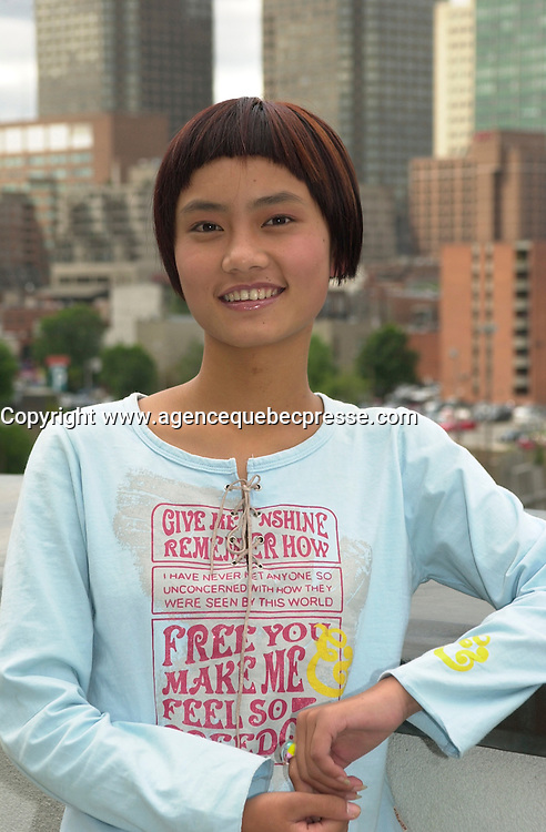 August 28,  2003, Montreal, Quebec, Canada<br /> <br /> Li Min, main actress in Zhang Jiarui movie<br /> RUOMA DE SHI SUI (When Ruoma was seventeen), presented in the Official Competition of the<br />  2003 Montreal World Film Festival, pose for an exclusive photo, with Montreal City in the background august 28 2003<br /> <br /> The Festival runs from August 27th to september 7th, 2003<br /> <br /> <br /> Mandatory Credit: Photo by Pierre Roussel- Images Distribution. (&copy;) Copyright 2003 by Pierre Roussel <br /> <br /> All Photos are on www.photoreflect.com, filed by date and events. For private and media sales