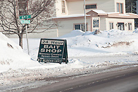 A sign advertises a 24-hour bait shop in Michigan's Upper Peninsula.