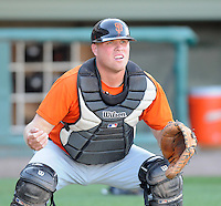 Catcher Dan Burkhart (15) of the Augusta GreenJackets, Class A affiliate of the San Francisco Giants, in a game against the Greenville Drive on April 7, 2011, at Fluor Field at the West End in Greenville, South Carolina. (Tom Priddy / Four Seam Images)