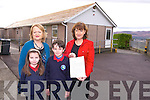 KilleenAnnette Dinneen, Principal with the letter from Ruairi Quinn TD Minister for Education, hoping the new school promised will be soon after the storm damage last week here with 3rd Class students Paddy Falvey and Kaley and  Mary Dillan, Deputy Principal, on Wednesday