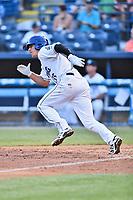 Asheville Tourists catcher Campbell Wear (35) runs to first base during a game against the West Virginia Power at McCormick Field on May 10, 2017 in Asheville, North Carolina. The Tourists defeated the Power 4-3. (Tony Farlow/Four Seam Images)