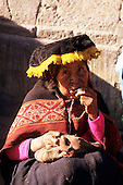 Paucartambo, Peru. Woman wearing traditional clothes and chewing coca leaves.