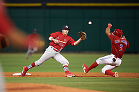 Palm Beach Cardinals second baseman Luke Dykstra (32) stretches for a throw as Jan Hernandez (3) slides into second base during the second game of a doubleheader against the Clearwater Threshers on April 13, 2017 at Spectrum Field in Clearwater, Florida.  Palm Beach defeated Clearwater 1-0.  (Mike Janes/Four Seam Images)
