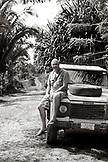 BELIZE, Punta Gorda, Toledo, the owner of the Sun Creek Lodge Bruno Kuppinger sits on his truck (B&W)
