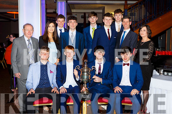 Killorglin basketballers with the Billy Kelly cup at the Kerry Sports Stars awards in the INEC on Friday night  front row l-r: David McCarthy, Liam Croake, Eoin O'Sullivan, Darragh O'Connor. Back row: Ivo O'Sullivan Snr, Ciara O'Sullivan, EwanWeldon, Eoin Evans, Ivo O'Sullivan, Una O'Sullivan. Back row: Caire Cleary, Kevin FitzPatrick and Conor Flynn