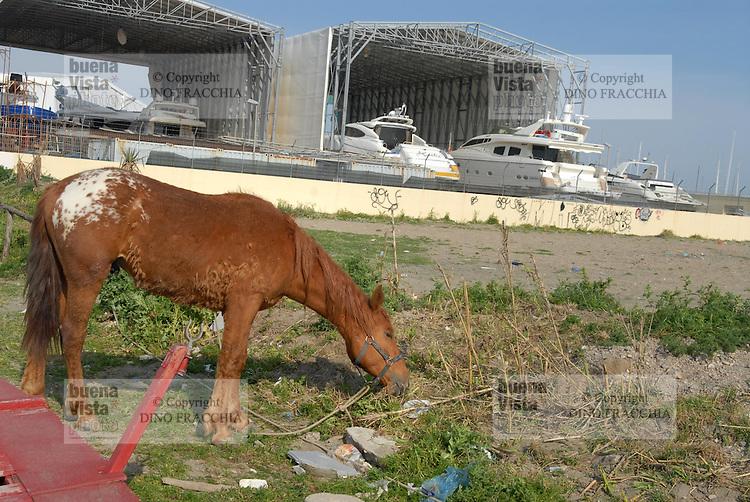 - Lido di Ostia, the degraded area of Foce Tevere-Idroscalo street; shipyards....- Lido di Ostia, area degradata di foce Tevere-via dell'Idroscalo; cantieri navali