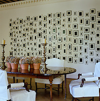A 192-piece artwork by Allan McCollum covers one wall of the dining room