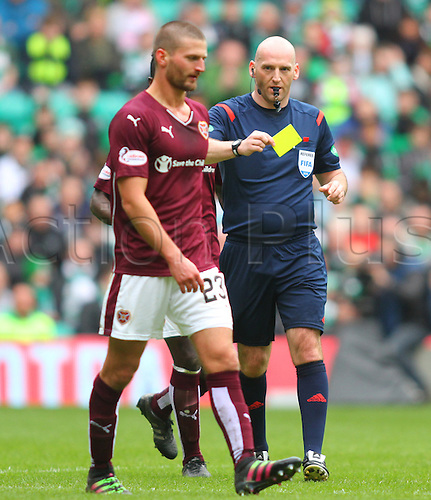 02.04.2016. Celtic Park, Glasgow, Scotland. Scottish Football Premiership Celtic versus Hearts. Perry Kitchen is yellow carded by Bobby Madden