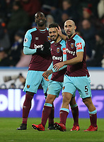 West Ham United's Manuel Lanzini celebrates scoring his side's fourth goal with Pedro Obiang and Pablo Zabaleta<br /> <br /> Photographer Rob Newell/CameraSport<br /> <br /> The Premier League - Huddersfield Town v West Ham United - Saturday 13th January 2018 - John Smith's Stadium - Huddersfield<br /> <br /> World Copyright &copy; 2018 CameraSport. All rights reserved. 43 Linden Ave. Countesthorpe. Leicester. England. LE8 5PG - Tel: +44 (0) 116 277 4147 - admin@camerasport.com - www.camerasport.com