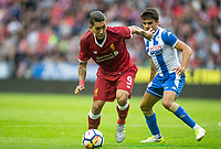 Roberto Firmino of Liverpool holds off Reece James of Wigan Athletic during the pre season friendly match between Wigan Athletic and Liverpool at the DW Stadium, Wigan, England on 14 July 2017. Photo by Andy Rowland.