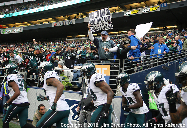Seattle Seahawks fan Rob Larsen holds a sign and taunts the Philadelphia Eagles as the depart the visitors locker room at CenturyLink Field in Seattle, Washington on November 20, 2016.  Seahawks beat the Eagles 26-15.    ©2016. Jim Bryant Photo. All Rights Reserved.