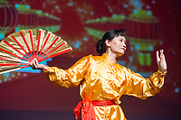NWA Democrat-Gazette/BEN GOFF @NWABENGOFF<br /> Dancers perform a traditional Chinese fan dance Saturday, Feb. 10, 2018, during the Chinese New Year Gala presented by the Chinese Association of Northwest Arkansas at Springdale Har-Ber High. The event celebrated the Year of the Dog with a dinner and a show featuring traditional and contemporary Chinese dance, music, fashion and more.