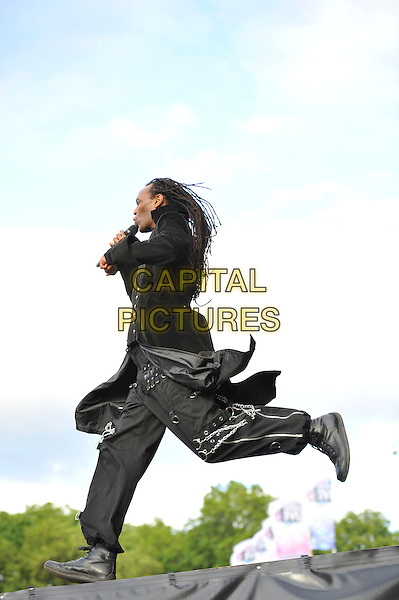 Ranking Roger of 'The Beat' .Performing at BT London Live, Hyde Park, London, England. .1st August 2012.on stage in concert live gig performance full length black jacket dreadlocks singing side profile jump jumping running .CAP/MAR.© Martin Harris/Capital Pictures.