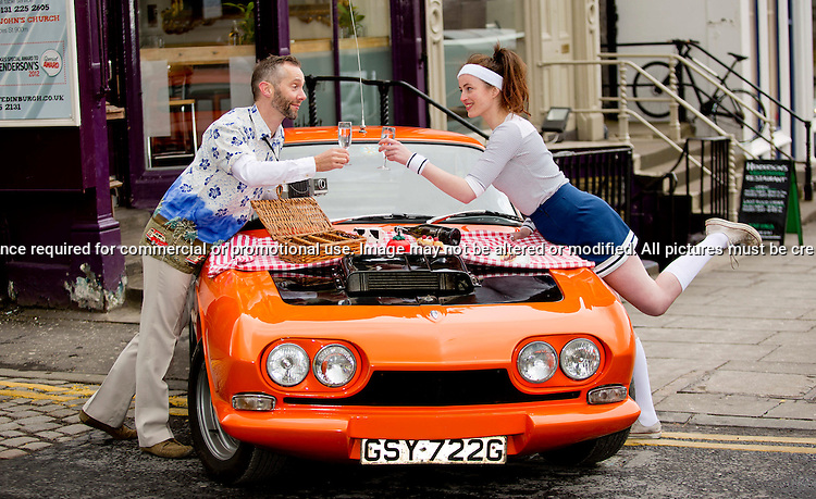 Back to the FoodTure - Scotland's Newest Food Festival launches with 60's style.Henderson's 50/50 Food Festival - A 50 Day Celebration of 50 years in Edinburgh.<br /> <br /> Pictured: Henderson's staff member, Rosalind Main and Festival Director, Simon Preston.<br /> <br /> Vehicle: Reliant Scimitar supplied by Four Wheel Motors<br /> <br /> Malcolm McCurrach New Wave Images UK - 26/03/2013