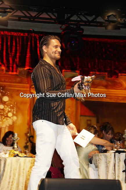 Mr. Romance 2010 Jamie Ungaro and puppy Lily are the winners of the costume contest at Romantic Times Booklovers Annual Convention 2011 - The Book Industry Event of the Year - April 6th to April 10th at the Westin Bonaventure, Los Angeles, California for readers, authors, booksellers, publishers, editors, agents and tomorrow's novelists - the aspiring writers. (Photo by Sue Coflin/Max Photos)