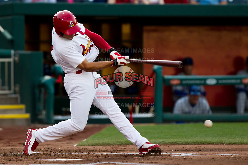 Thomas Pham (4) of the Springfield Cardinals hits a ground ball during a game against the Tulsa Drillers on April 29, 2011 at Hammons Field in Springfield, Missouri.  Photo By David Welker/Four Seam Images.