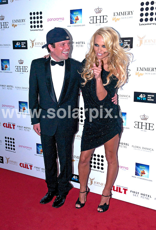 **ALL ROUND PICTURES FROM SOLARPIX.COM**                                             **UK AND SPAIN SYNDICATION RIGHTS ONLY**                                                                                  Pamela Anderson hosting Claus Hjelmbak's Scandinavian Style Mansion Party at First Hotel Skt. Petri in Copenhagen, Denmark                                                                            This pic:     Pamela Anderson & Claus Hjelmbak                                                                                         JOB REF:  13695   CPR Starlounge  DATE:  12.07.11                                                          **MUST CREDIT SOLARPIX.COM OR DOUBLE FEE WILL BE CHARGED**                                                                      **MUST AGREE FEE BEFORE ONLINE USAGE**                               **CALL US ON: +34 952 811 768 or LOW RATE FROM UK 0844 617 7637**