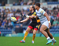 Andy Goode passes the ball. Pre-season friendly match, between London Wasps and London Irish on August 24, 2013 at Adams Park in High Wycombe, England. Photo by: Patrick Khachfe / Onside Images