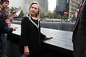 On the 10th anniversary of the September 11th terrorist attacks, United States Secretary of State Hillary Rodham Clinton (left), wife of former U.S. President Bill Clinton, pauses for a moment of reflection at the South Memorial Pool at opening day of the September 11th Memorial at the World Trade Center site in New York, New York on September 11, 2011..Credit: Jefferson Siegel / Pool via CNP