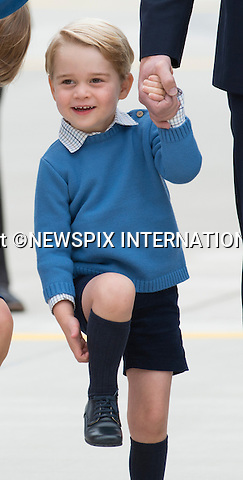 24.09.2016; Victoria, Canada: SHADES OF BLUE - DUKE &amp; DUCHESS OF CAMBRIDGE, PRINCE GEORGE AND PRINCESS CHARLOTTE<br />arrive on a RCAF aircraft at the start of their tour of Canada at Victoria Airport.<br />Kate Middleton chose a Jenny Packam outfit with a matching blue hat from Lock &amp; Co.<br /> Princess Charlotte, Prince George and Prince William wore oufits in shades of blue.<br />The tour will take Royals to parts of both British Columbia and the Yukon.<br />Mandatory Photo Credit: &copy;Francis Dias/NEWSPIX INTERNATIONAL<br /><br />IMMEDIATE CONFIRMATION OF USAGE REQUIRED:<br />Newspix International, 31 Chinnery Hill, Bishop's Stortford, ENGLAND CM23 3PS<br />Tel:+441279 324672  ; Fax: +441279656877<br />Mobile:  07775681153<br />e-mail: info@newspixinternational.co.uk<br />Usage Implies Acceptance of OUr Terms &amp; Conditions<br />Please refer to usage terms. All Fees Payable To Newspix International