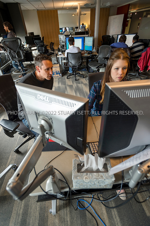 6/18/2012--Bellevue, WA, USA..Valve Software's offices in Bellevue, WASH., just east of Seattle. The office is set up as a 'boss less' office that is fluid and non-hierarchical. Desks come with wheels so that they can be easily moved and reconfigured to create new work spaces for new projects. The desks can also be raised or lowered for comfort or to create a standing work space...Here, Valve employees working, including John Cook  (left) and Emily Kent (right) on the 8th floor, on networking systems for the games the company makes...Stuart Isett for The Wall Street Journal
