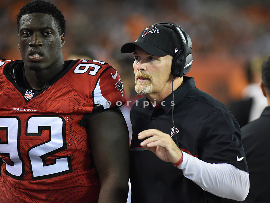 CLEVELAND, OH - AUGUST 18, 2016: Head coach Dan Quinn of the Atlanta Falcons talks with defensive lineman Joey Mbu #92 on the sideline in the fourth quarter of a preseason game on August 18, 2016 against the Cleveland Browns at FirstEnergy Stadium in Cleveland, Ohio. Atlanta won 24-13. (Photo by: 2016 Nick Cammett/Diamond Images) *** Local Caption *** Dan Quinn; Joey Mbu