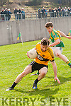 Listowel Emmets Maurice Whelan in possession of the ball closely watched by Lios Póil Ryan Ó Mannín during the Junior Club Football Championship match in Lispole on Sunday afternoon.