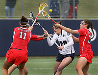 Penn State's Taylor Bleistein (28) against Ohio State's Meg Camden (11), Paulina Constant, rear, and Shannon Rosati, right, on April 1, 2017. No. 6 Nittany Lions won 16-12 over the Buckeyes.  Photo/©2017 Craig Houtz