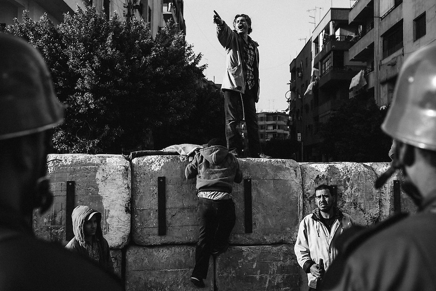 An Egyptian opposition protester chants against Egyptian President Mohammed Morsi from the top of a wall near the Presidential Palace on December 9, 2012 in Cairo, Egypt. PHOTO: ED GILES.