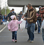 Refugees walk across the border into Austria near the Hungarian town of Hegyeshalom. Hundreds of thousands of refugees and migrants--including many families--flowed through Hungary in 2015, on their way to western Europe from Syria, Iraq and other countries.