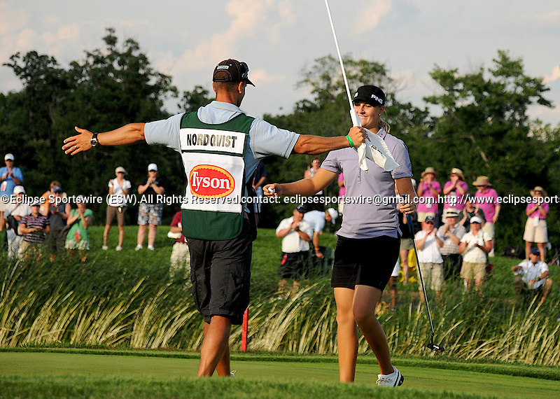 14 JUN 09: Anna Nordqvist gets a hug from her caddie after sinking the final putt for a win at the McDonald's LPGA Championship in Havre De Grace, Maryland