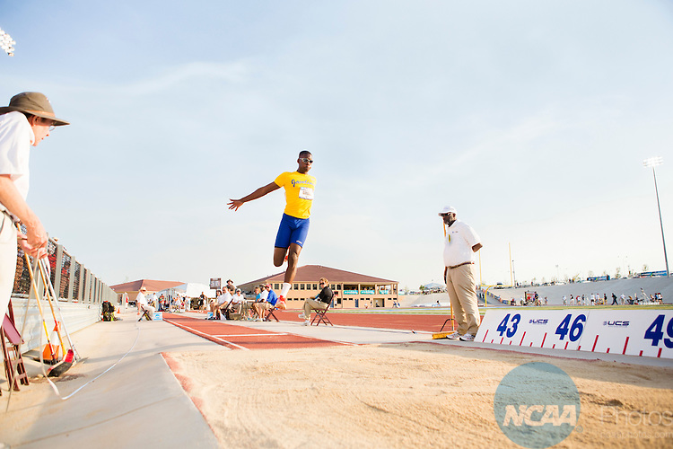 26 May 2012:   CJ Griggs of Texas A&M University-Kingsville competes in the Men's Triple Jump during the NCAA Division II Outdoor Track and Field Championships at the Neda and Eddie DeRose Thunderbowl on the Colorado State University at Pueblo campus in Pueblo, CO.  Griggs took home the triple jump title with a jump of 15.78 meters.   ©Trevor Brown Jr./NCAA Photos