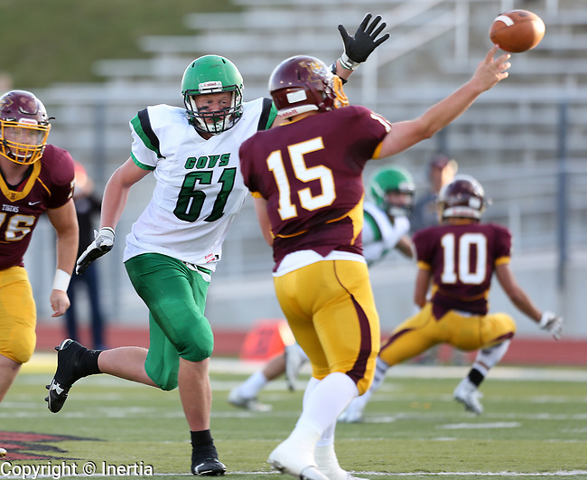 HARRISBURG, SD - SEPTEMBER 26: Jacob Beastrom #61 from Pierre applies pressure as quarterback Troy Knecht #15 from Harrisburg passes the ball in the second half of their postponed game Tuesday evening in Harrisburg. (Photo by Dave Eggen/Inertia)
