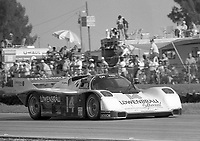 #14 Porsche 962 of Al Holbert, Derek Bell and Al Unser, Jr. races to 2nd place finish in the 12 Hours of Sebring, at Sebring Raceway, Sebring, FL, March 23, 1985.  (Photo by Brian Cleary/www.bcpix.com)