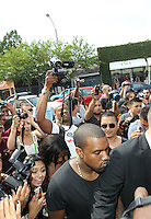 Kim Kardashian and Kanye West caused a fan and paparazzi frenzy while arriving the the opening of their new DASH! store on posh Melrose in West Hollywood. Los Angeles, California on 13.7.2012..Credit: Correa/face to face.. /MediaPunch Inc. ***FOR USA ONLY*** ***Online Only for USA Weekly Print Magazines***