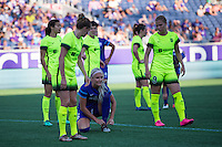 Orlando, Florida - Sunday, May 8, 2016: The game is delayed while Orlando Pride midfielder Kaylyn Kyle (6) ties her shoe during a corner kick of a National Women's Soccer League match between Orlando Pride and Seattle Reign FC at Camping World Stadium.