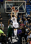 January 14, 2012:   Nevada Wolf Pack forward Olek Czyz dunks  over Hawai'i Rainbow Warriors center Vander Joaquim during their NCAA basketball game played at Lawlor Events Center on Saturday night in Reno, Nevada.