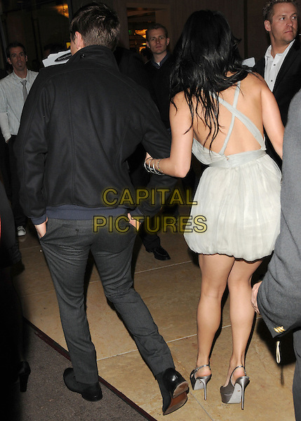 ZAC EFRON & VANESSA HUDGENS.Leaving the 67th Golden Globes held at The Beverly Hilton Hotel in Beverly Hills, California, USA..January 17th, 2010 .departures full length black jacket grey gray trousers back behind rear couple dress grey gray.CAP/DVS.©Debbie VanStory/Capital Pictures