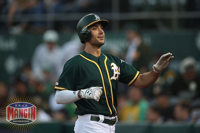 OAKLAND, CA - AUGUST 20:  Matt Olson #28 of the Oakland Athletics celebrates after hitting a home run against the New York Yankees during the game at the Oakland Coliseum on Tuesday, August 20, 2019 in Oakland, California. (Photo by Brad Mangin)
