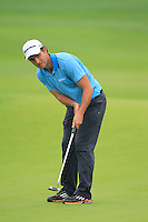 Edoardo Molinari (ITA) putts on the 9th green during Thursday's Round 1 of the 2014 BMW Masters held at Lake Malaren, Shanghai, China 30th October 2014.<br /> Picture: Eoin Clarke www.golffile.ie