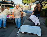 Julie Linford, Ray Zeeb, and Susan Smith pack empty traps back into Zeeb's truck after returning presiously trapped to their outside home areas in Antioch, California, on Saturday, March 22, 2014.  All of the cats have been spayed/neutered, vaccinated and ear tipped.  Smith runs Rivertown Cats and volunteers for H.A.R.P., Zeeb volunteers for H.A.R.P. (Homeless Animal Response Program) and Linford runs Outcast Cat Help of Martinez.  Photo/Victoria Sheridan