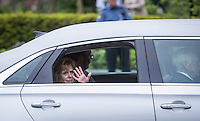 Lisette Lapointe, wife of former Quebec premier Jacques Parizeau, waves to the crowd gathered around the National Assembly in Quebec City on Sunday June 7, 2015.