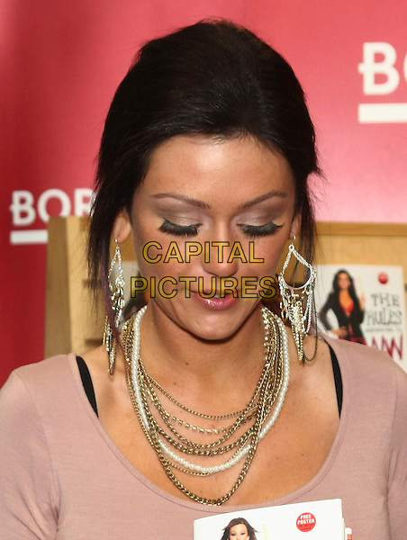 JENNI FARLEY (JWoww).'The Rules According to JWoww' book signing at Borders Columbus Circle, New York, USA, 9th February 2011..portrait headshot looking down false earrings dangly chains necklace silver beige brown false eyelashes .CAP/LNC/TOM.©LNC/Capital Pictures.