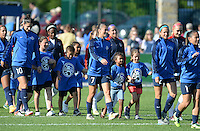 Kansas City, MO - Saturday July 16, 2016: Yael Averbuch, Mandy Laddish, Shea Groom, escort kids prior to a regular season National Women's Soccer League (NWSL) match between FC Kansas City and the Washington Spirit at Swope Soccer Village.