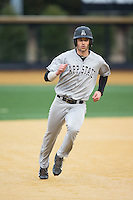 Michael Pierson (22) of the Appalachian State Mountaineers hustles towards third base against the Wake Forest Demon Deacons at Wake Forest Baseball Park on February 13, 2015 in Winston-Salem, North Carolina.  The Mountaineers defeated the Demon Deacons 10-1.  (Brian Westerholt/Four Seam Images)