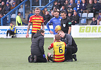 Referee Andrew Dallas oversees Sean McGinty getting treatment in the SPFL Ladbrokes Championship football match between Queen of the South and Partick Thistle at Palmerston Park, Dumfries on  4.5.19.