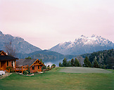ARGENTINA, Patagonia, Llao Llao Hotel in Nahuel Huapi National Park against snow covered mountains